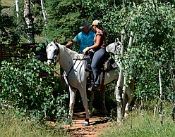 Horses and riders at trailhead for Cascade Falls hike, Dixie National Forest, Utah