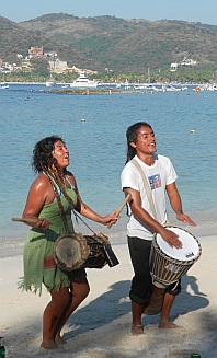 Bongo players on Las Gatas Beach, Zihuatanejo, Mexico.