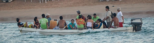 Workers take a water shuttle home from Ixtapa Island, Mexico.