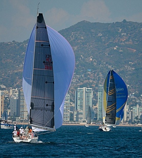 Downwind spinnaker run towards Acapulco's highrises on the beach.