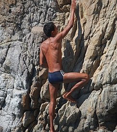Cliff Diver Alejandro scales the rocks in La Quebrada.
