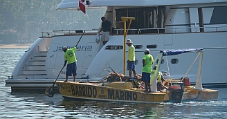 The Sea Sweepers, Barrido Marino, pick up used motor oil and household trash from boats.