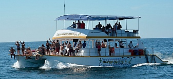 Tourist boats offer a day on the water at Bays of Huatulco, Mexico