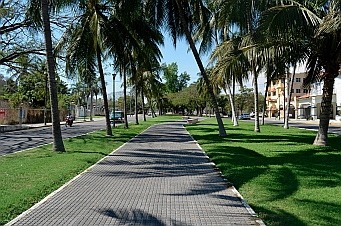 Wide grass-lined sidewalks lead to the town of La Crucecita, Bays of Huatulco, Mexico