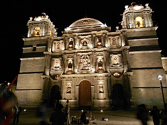 The Santo Domingo Cathedral lights up the night sky in Oaxaca, Mexico