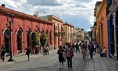 Charming historic buildings on the cobbled pedestrian street in Oaxaca, Mexico