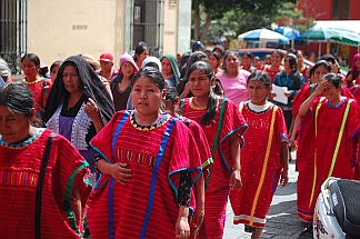 Red clad protesters in Oaxaca, Mexico