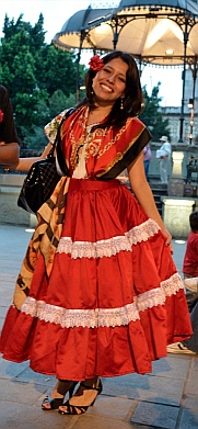Pretty girl in a pretty dress at the Zocalo, Oaxaca, Mexico