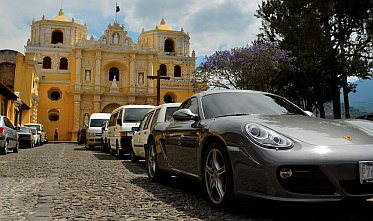 Porsche parked in front of cathedral in Antigua, Guatemala