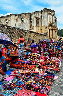 Mayans sell colorful weavings in Antigua, Guatemala