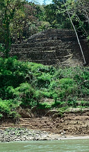 Yaxchilan & Bonampak Tour - We spot the edge of the Yaxchilán ruins through the trees.