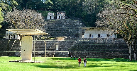 Yaxchilan & Bonampak Tour - Bonampak'a main plaza has shaded stelae and an enormous stairway with small buildings.