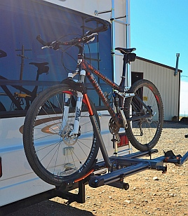With hitch extension on Kuat NV bike rack bike is well of the ground