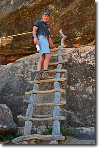 climbing a wooden ladder at Natural Bridges.