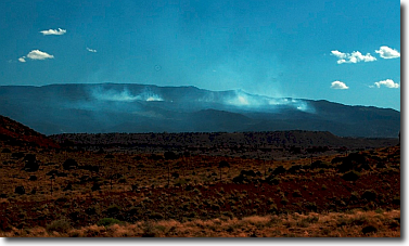 Utah wildfire smolders int the distance.