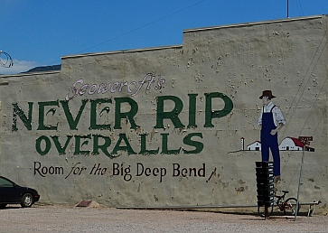 Scowcroft Never Rip Overalls mural on the wall of Grass Valley Mercantile Company in Koosharem Utah.